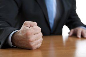 man with fist on table demonstrating workplace violence training course